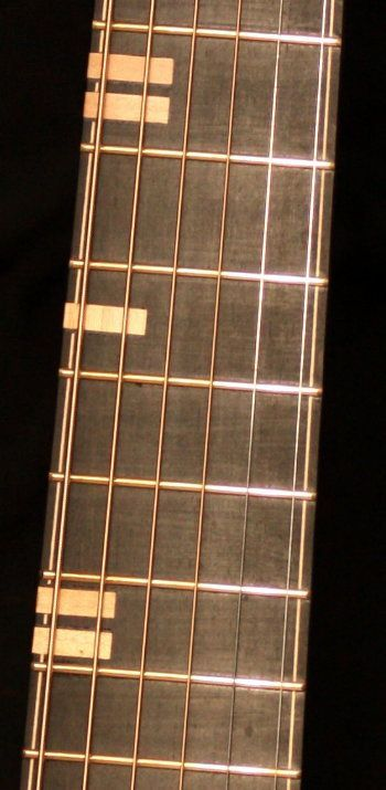"""Fretboard Maple block inlays which also wrap around the side of the fret board"" - McKnight Guitars"