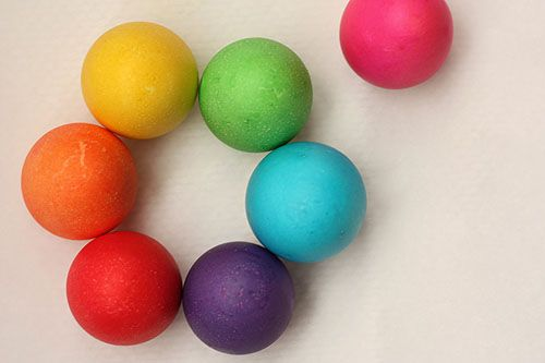 seven eggs, red, orange, yellow, green, blue, purple and magenta