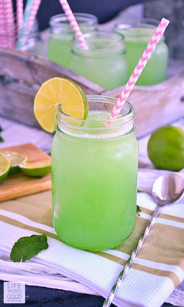 This Mojito Slush recipe   by Life Tastes Good is a mix of frozen limeade, grapefruit soda, fresh mint, and rum. The combination of sweet refreshing citrus and mint flavors with a little kick of rum is a popular summer cocktail. Perfect for a pool party!