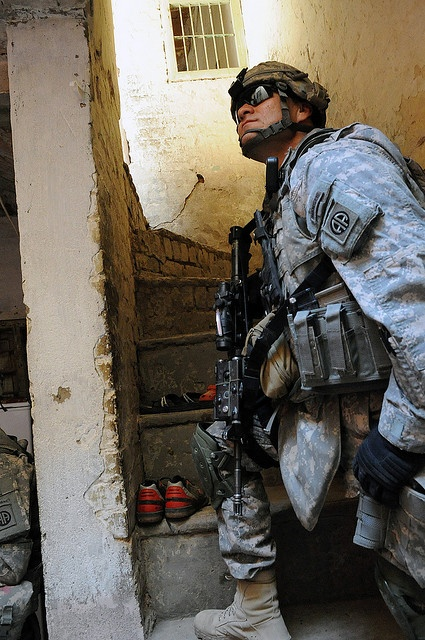BE4 YOU JUDGE THEM, TRY TO UNDERSTAND WHAT THEY ARE WORKING WITH. -U.S. Army Capt. Frank Rodriguez, Commander of A Troop, 5th Squadron, 73rd Cavalry Regiment, 3rd Brigade Combat Team, 82nd Airborne Division, looks up a stairwell while Iraqi and U.S. Soldiers search a residence (U.S. Army photo by Staff Sgt. James Selesnick/Released)