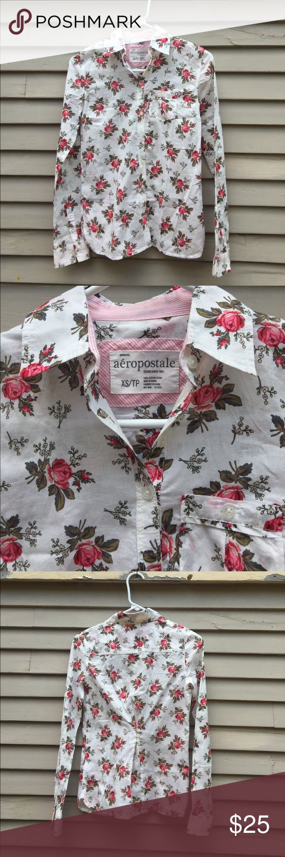 Aeropostale button down white roses floral summer Like new! Perfect condition. Small buttons cinch the shirt a little in the back. Lightweight handkerchief weight cotton and perfect for summer. Aeropostale Tops Button Down Shirts