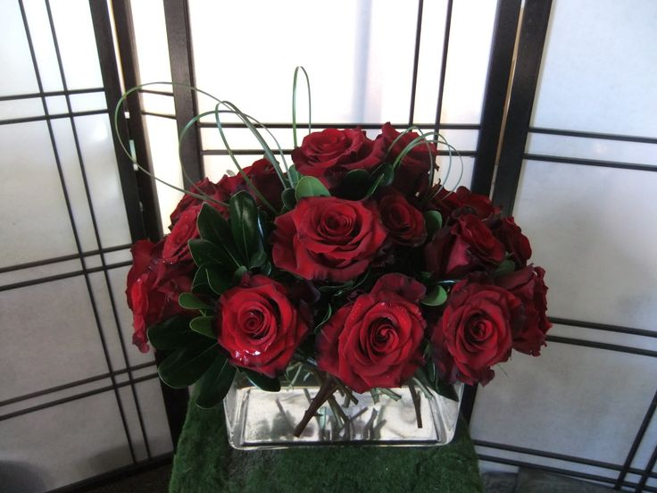 Lasting Romance-red roses in rectangular glass cube with bear grass & pittosporum