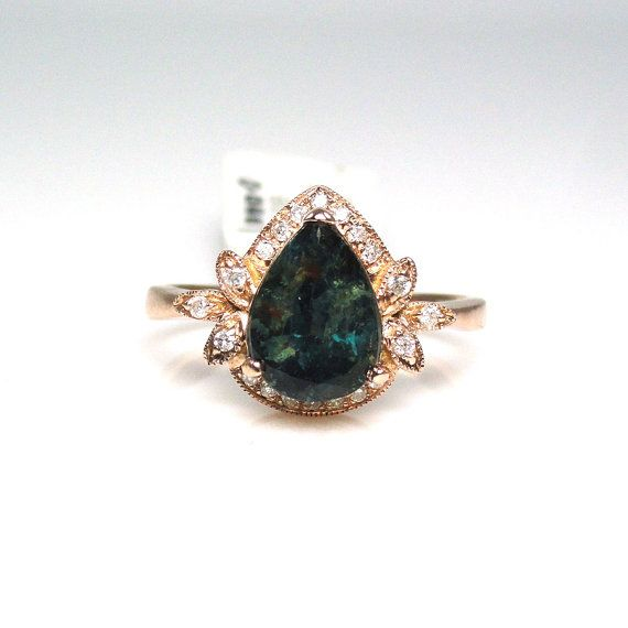 2.08 carat natural alexandrite ring with diamond by bestingems on etsy.com. this ring has my eye! natural alexandrite, classy, simple enough, good size (1ish-2ish carats). not bad makings to an engagement ring i would adore. i spend afternoons daydreaming about this ring...