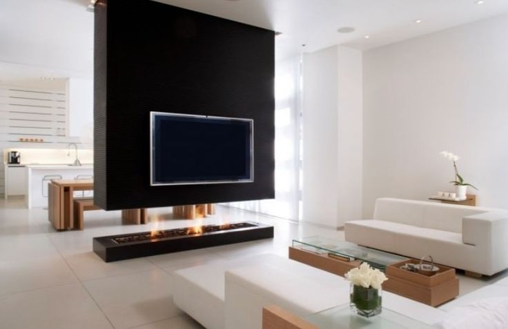 Modern fireplaces are so much more efficient than they used to be so they are no longer relegated to an outside wall where they can get an air draw without...