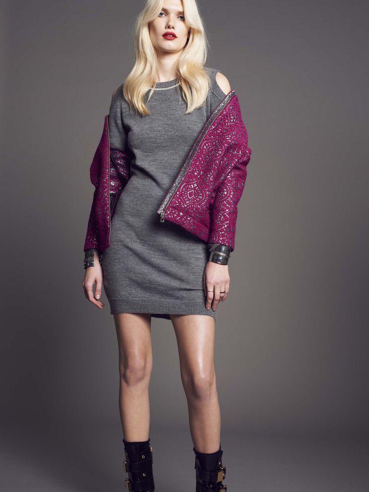 Model wears Naughty Dog wool dress with rounded neckline and Swarovski decorations; magenta damask #coat.