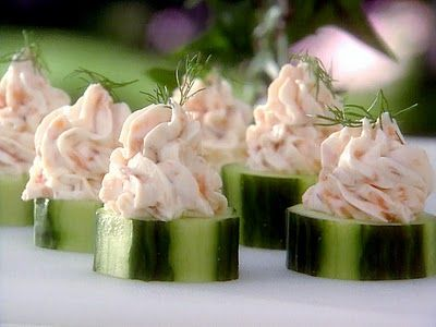 Smoked Salmon & Cream Cheese Bites |  ..2 cucumbers  ..8 oz. plain cream cheese  ..4 oz. sour cream  ..8 oz. smoked salmon, minced  ..1/2 lemon, juiced