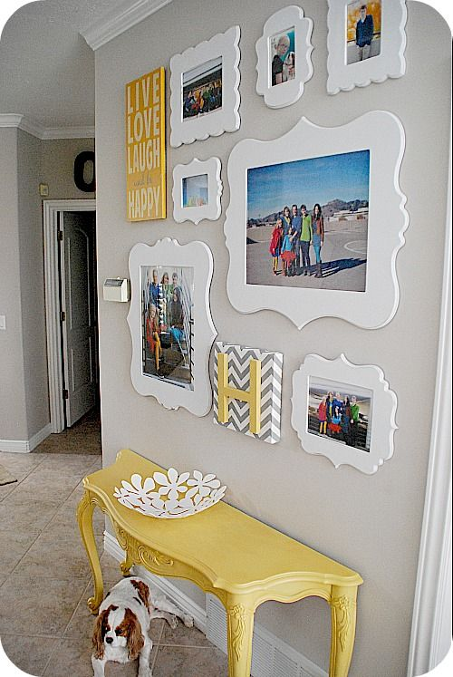 Photo wall. I love the chevron letter on the bottom.