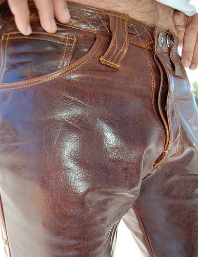 Men's leather jeans with stitching detail around the waistband and on the belt loops