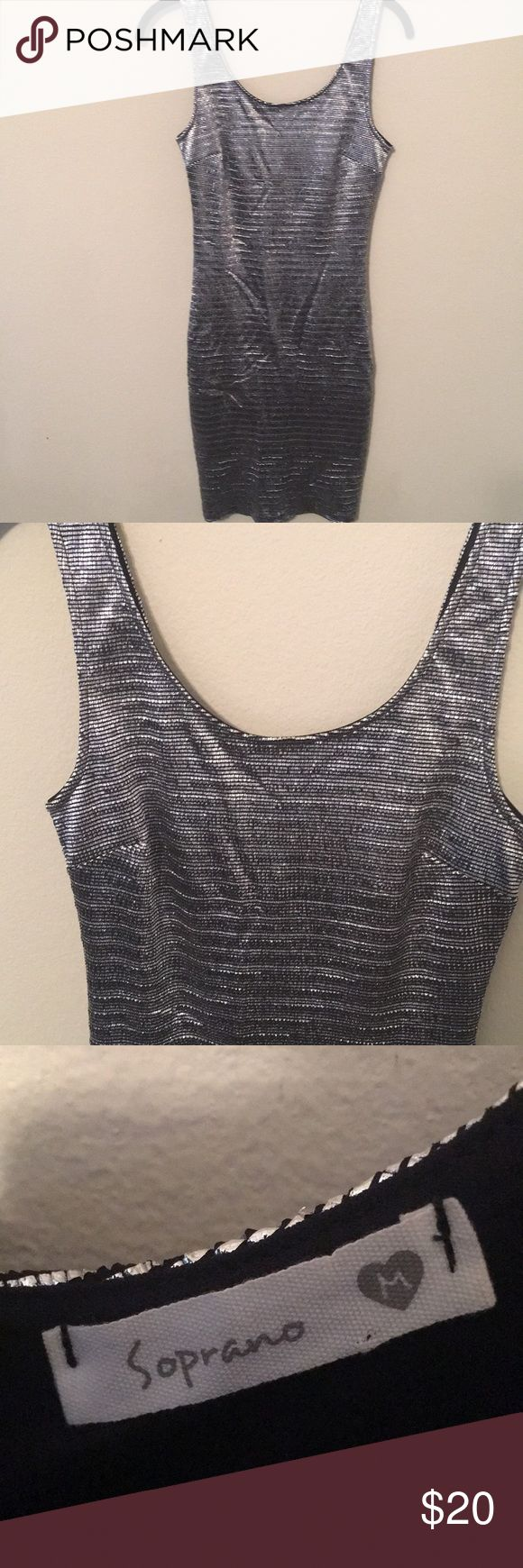 Metallic silver bodycon dress Metallic silver bodycon dress, size medium, worn once, like new condition Soprano Dresses Mini