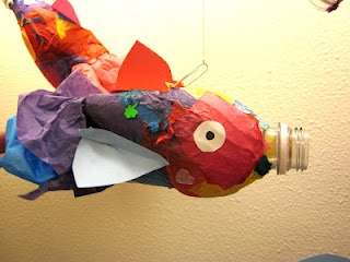 great way to recycle and teach kindergarten sculpture, not to mention i have tissue paper coming out my ears in my classroom