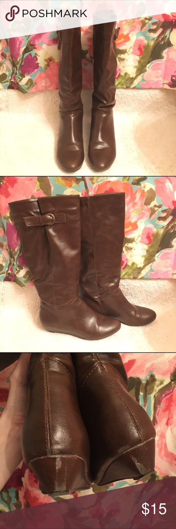 Brown Wedge Heel Boot Brown wedge heel boots. Buckle for adjust for wider calves. Small scuff on backs of heels as shown in pictures, not noticeable while wearing since they are underneath. Comfortable wearing all day. Similar to Steve Madden Intyce boots. American Eagle Outfitters Shoes Heeled Boots
