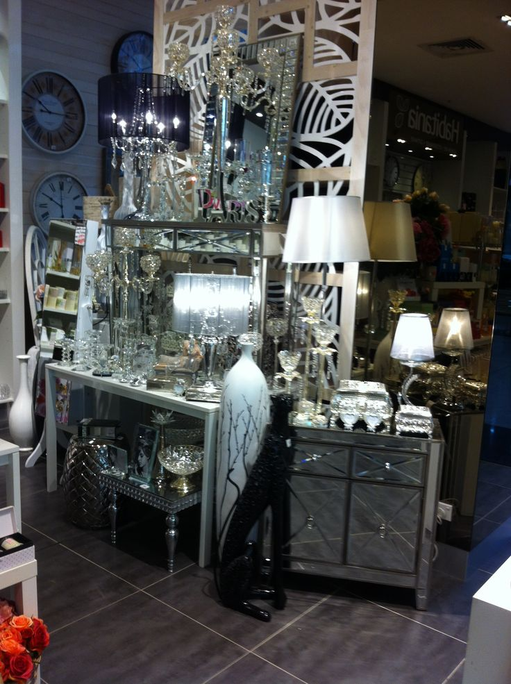 Bling and more bling. Black,cheetah statue, mirrored bedside table and console table. Lamps with multiple globes