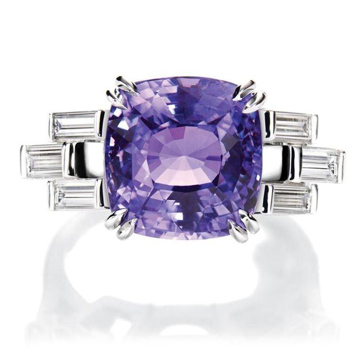Harry Winston Color-change Purple Sapphire and Baguette Diamond Ring.  Cushion-cut purple sapphire, 8.10 carats; 6 baguette diamonds, 0.96 total carats; platinum setting.