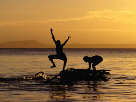 Children Playing on Lake Taupo, Taupo, New Zealand Photographic Print by Michael Coyne at AllPosters.com