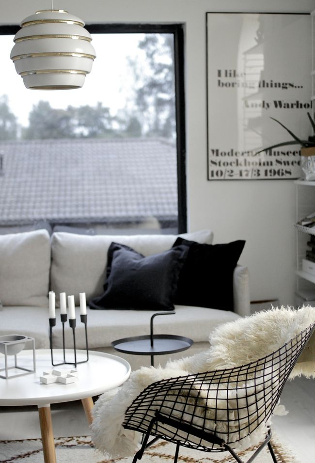 Cosy monochrome living room featuring a plethora of design classics including #knoll Bertoia Diamond Chair & Artek Beehive pendant Light. Both available at Utility. Get the look today: https://www.utilitydesign.co.uk/artek-a331-beehive-pendant-light
