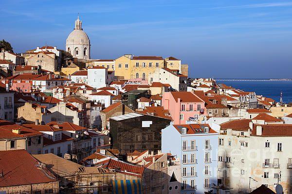 Sweeping view over Alfama historical district in city of Lisbon in Portugal. #lisbon #lisboa #portugal #city #capitalcity #alfama #houses #homes #urbanphotography #cityscape #skyline #fineartprints #artprint #print #europe #europetrip  #architecturephotography #urbanlandscape #citybreak #travel #historicalplace