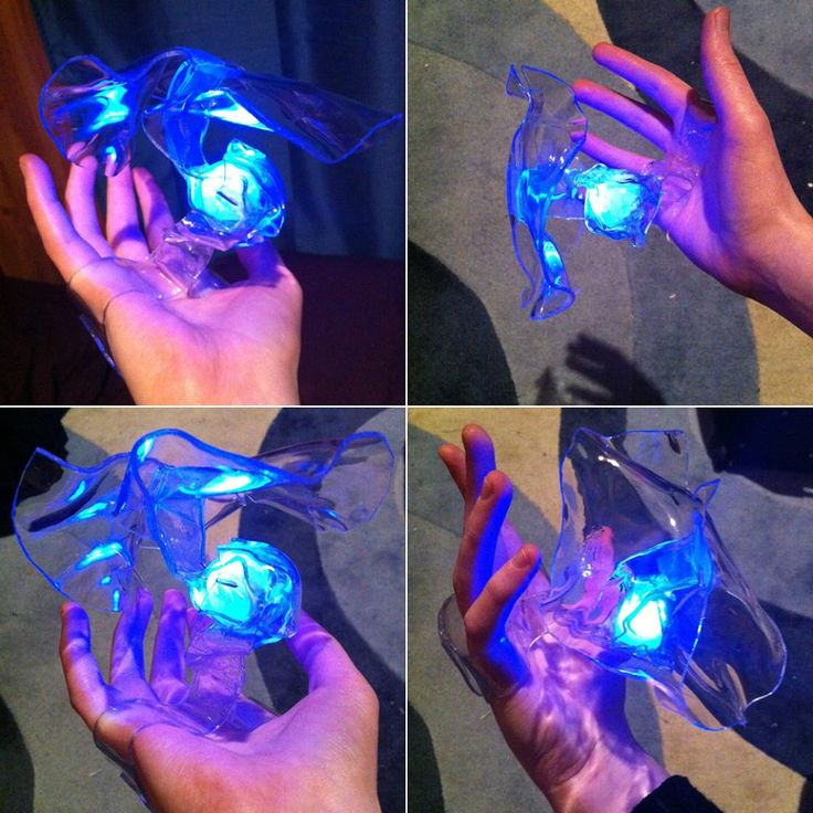 Heat-shaped PETG plastic + 1 LED berry light + tracing paper to defuse LED 1: Wraps around hand, merges then forms a holder/container for the LED berry light ball 2: The middle of this piece firmly wraps around the light ball, merges together then spreads out into that wavy thing.  Piece 2 snaps into 1 (the plastic allows for a bit of flexing)