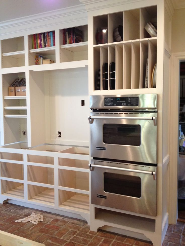 If we ever re-do the kitchen, I want THIS -- double ovens, vertical storage for baking pans.