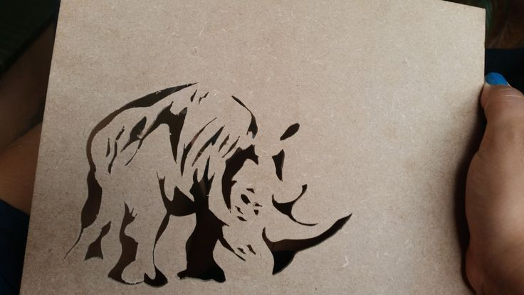 Rhino pattern done on box lid with fret saw