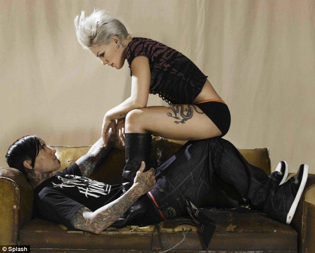 Pink and Carey Hart-- an amazing shot! One of my favorite unconventional yet sexy/bad ass/domineering poses. I would love to see this.