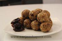 Khajoori Farhali Laddoo: Dates sauteed with dried fruits, fresh coconut, semolina and powdered sugar and shaped into laddoos.