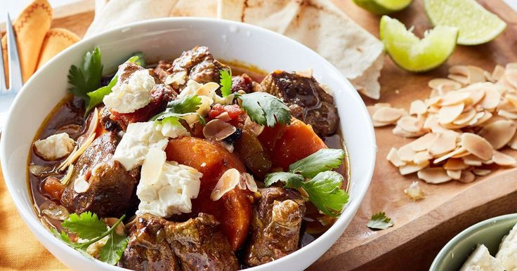 Crumbled fetta, flaked almonds and fresh lebanese bread add a delicious Moroccan spin to this tender beef casserole.