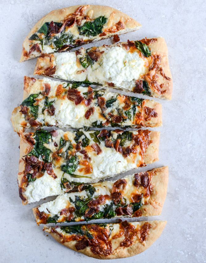 White Pizza with Spinach and Bacon by How Sweet Eats. Errrrmagosh. This pizza. I don't know how to fully express my love. Also, do you even know how long it's been since I shared a recipe with bacon? Um. Too