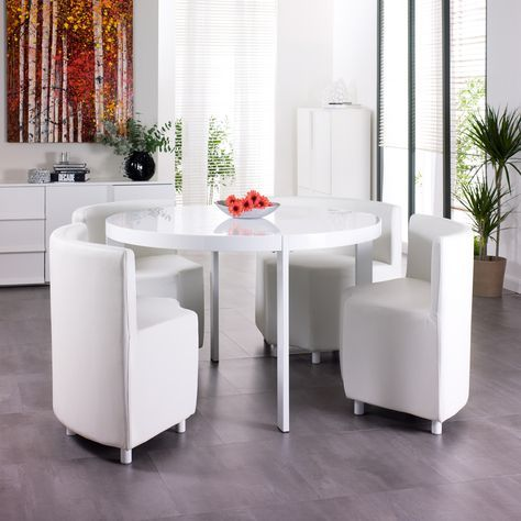 Make the most of your dining space. The upholstered faux leather chairs, which come fully assembled, sit on small gloss feet and slide beneath the white gloss dining table when not needed. A great table for the kitchen or ideal for a smaller dining room.