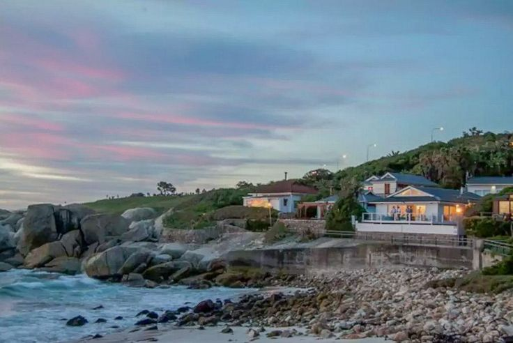 Glen Beach 3 – a 12 sleeper beach bungalow set in the intimate and gorgeous Glen Beach. Glen Beach sits between the popular Camps Bay Beach and glamorous Clifton beaches. This holiday villa features a private pool and jacuzzi. Walk onto the snow-white sands of Glen Beach from your front door. Luxurious entertainment and living areas open up to expansive panoramic sea and mountain views. Bask in the sun with a cocktail in hand and enjoy the sounds of the waves crashing onto the beach.