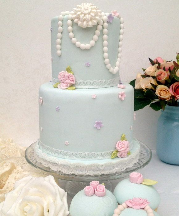 A cute mini 2 tier cake in soft blue small cake with for Cute simple cakes