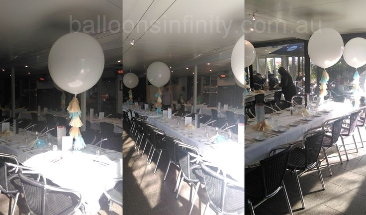 Large white balloons with tassel line. #largeheliumballoons #largepartyballoons #largeweddingballoons