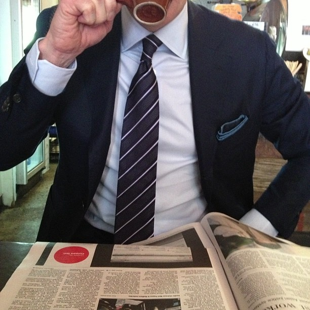 Guys in suits reading Financial times