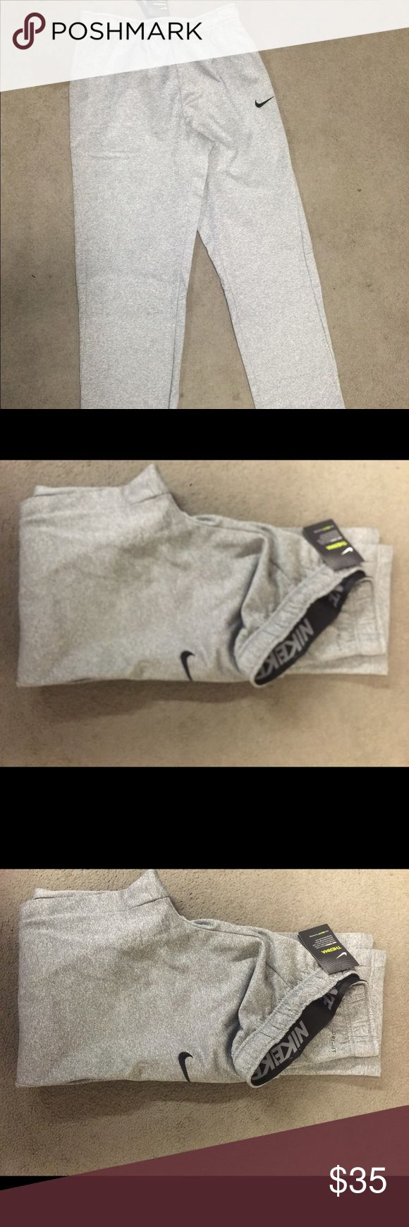 Nike MENS big and tall Dri-Fit sweatpants Brand new with tags never worn big and tall ! I have a regular big and tall (4XLT) Nike Pants Sweatpants & Joggers