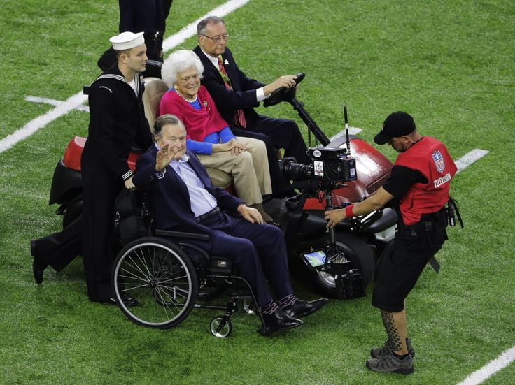 Former President George H.W. Bush and wife, Barbara arrive on the field before the NFL Super Bowl 51 football game between the New England Patriots and the Atlanta Falcons, Sunday, Feb. 5, 2017, in Houston. | Former President George H.W. Bush and his wife, Barbara, took part in the pregame coin toss — and the New England Patriots had the ball first in Super Bowl 51.