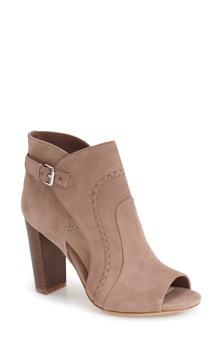 This sultry suede bootie is set on a stacked woodgrain heel and styled with a daring peep toe and side cutouts, for a look that will instantly update any outfit.