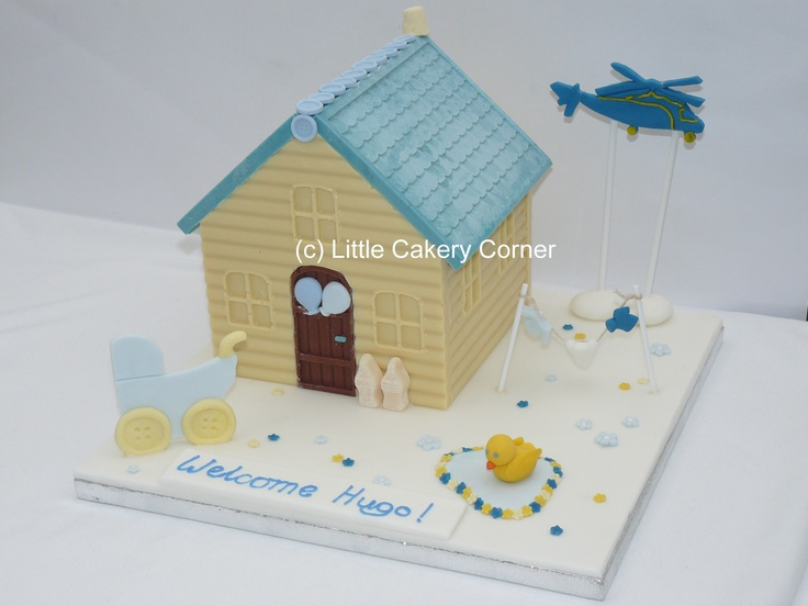 A stunning chocolate house to welcome a new born baby boy or for his Christening / Baptism / Dedication / Naming Day or even 1st Birthday!  In lovely pastel shades of white, lemon yellow, pale blue and dark blue - this is a beautiful alternative to cake.  It is made from white chocolate, milk chocolate - and pale blue chocolate!!                         This particular design has incorporated a helicopter, as daddy is a helicopter pilot.