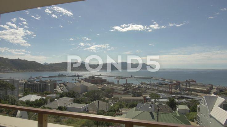 4k Wide Shot From Balcony Naval Dockyard Pier Ocean Mountains In Background View - Stock Footage   by RyanJonesFilms