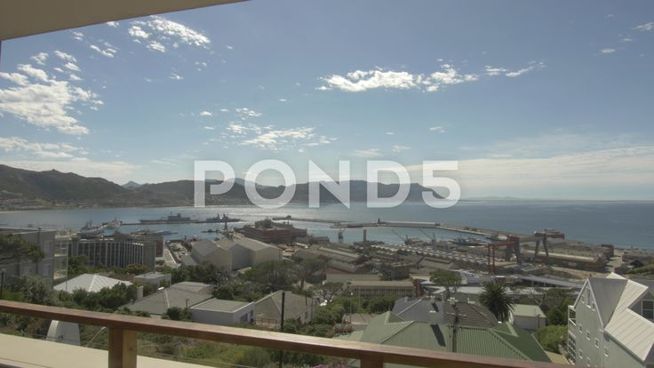 4k Wide Shot From Balcony Naval Dockyard Pier Ocean Mountains In Background View - Stock Footage | by RyanJonesFilms