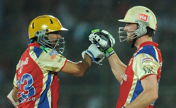 Tillakaratne Dilshan and AB de Villiers put on an unbroken 122-run stand off 50 balls on Monday as Royal Challengers Bangalore defeated Rajasthan Royals by 46 runs in the Indian Premier League.