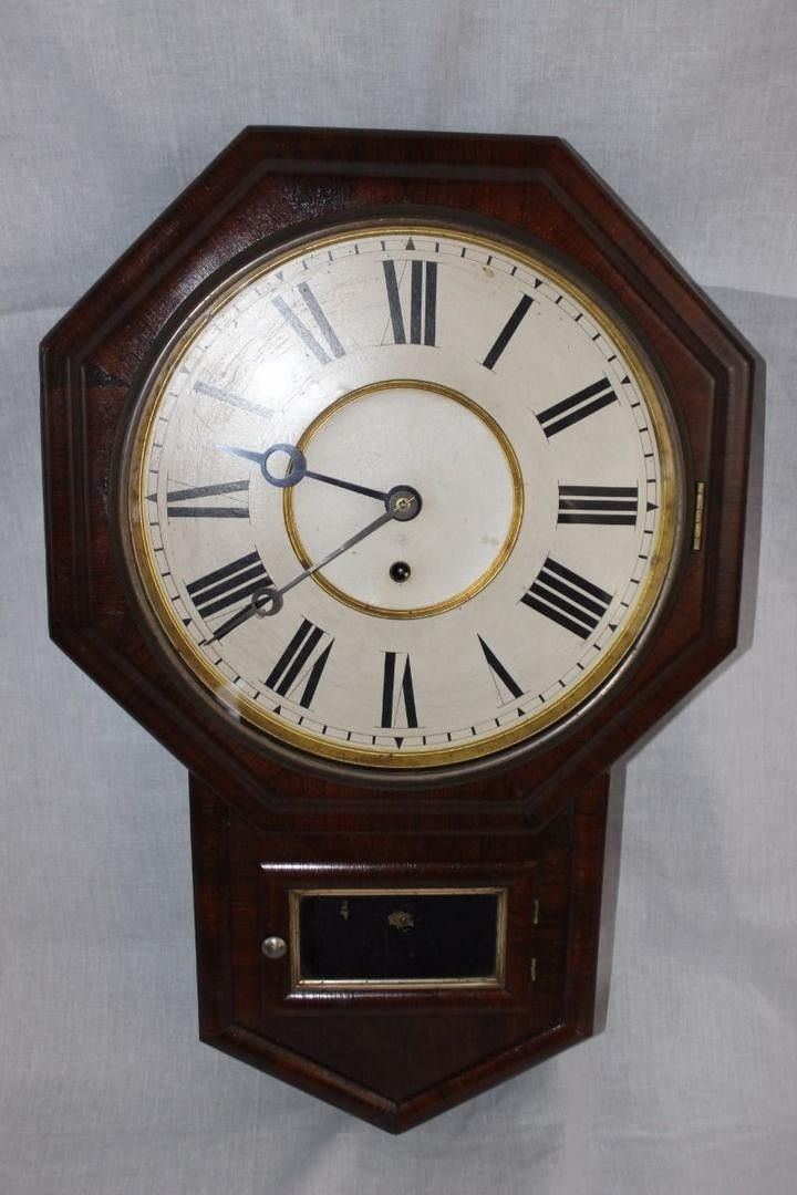 DESCRIPTION For your consideration is this nice Antique GIlbert 12 Inch Octagon drop Regulator Clock. Approximate dimensions are 25 inches tall by 16.5inches wide by 4.75 inches deep. Clock is comple