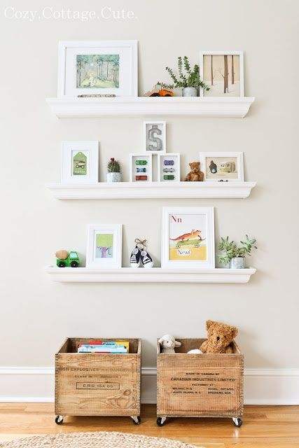 crates on casters, white shelves, leaning frames, and plants. Perfect for the last wall of the nursery!