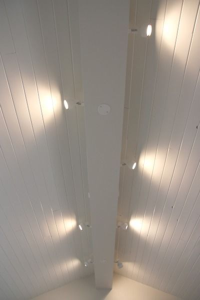 Track lighting installed to wash the vaulted ceiling with for Half vaulted ceiling with beams
