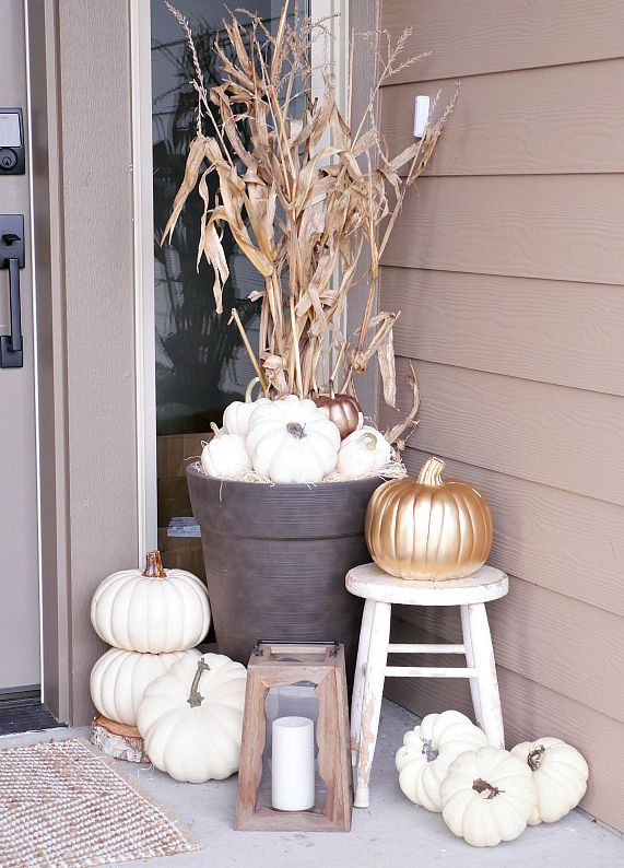 White pumpkins are a chic alternative to the ubiquitous orange variety. Spray paint them gold for a hint of glam amidst the gore. | Source: Design Dining and Diapers