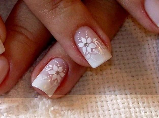 White floral/flower nail art with silver rhinestones on a french manicure ♡