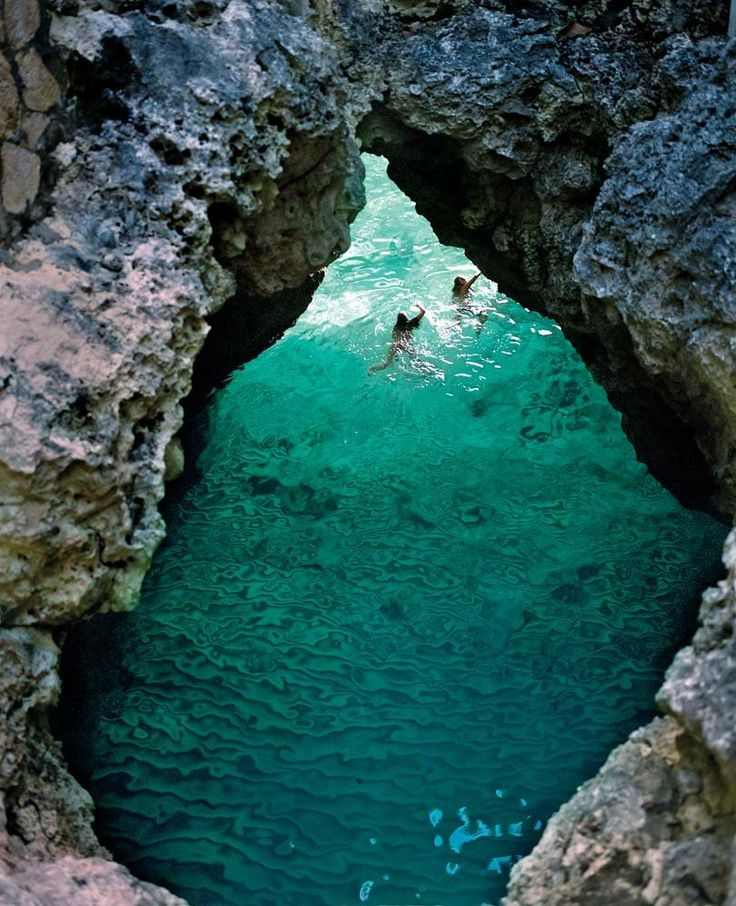 Swimming in a grotto at the Caves Resort in Negril, Jamaica