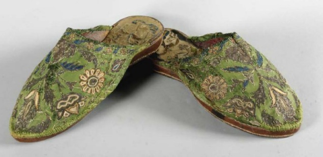 Pair of gentleman's embroidered mules - ottoman empire 18th century. Uppers of green satin embroidered in chain stitch with silver thread. Leather soles.