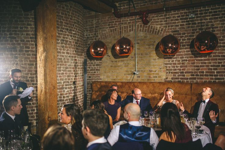 The best man wedding speech digging dirt on the groom ;) at the Rum Club London Wedding Photographer © Miki Photography