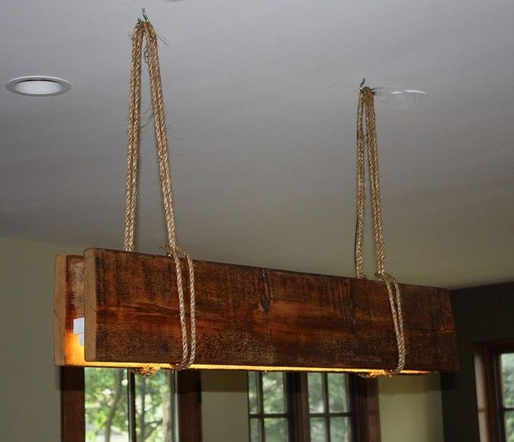 A fluorescent glow light using reclaimed wood and rope - very rustic! Make sure…