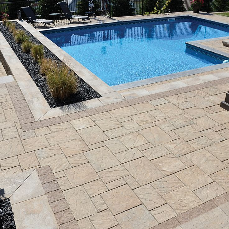 Poolside landscape. Project application using Ridgefield Plus pavers. Color: Ridgefield Plus Vaughan by Oaks Landscape Products.