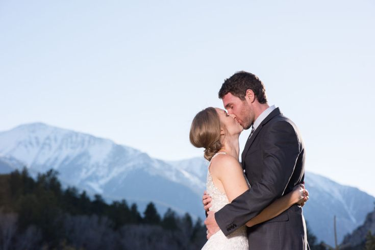 Vibrant Photo at Sunset with Mountain background.  Photos where the Couple pops.  Kiss Photo